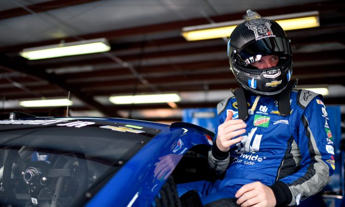 Dale Earnhardt Jr, driver of the #88 Nationwide Chevrolet, climbs into his car during practice for the NASCAR Sprint Cup Series GEICO 500 at Talladega Superspeedway on April 29. (Jared C. Tilton/Getty Images)