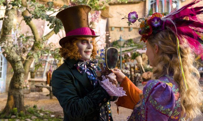 """This image released by Disney shows Johnny Depp as the Mad Hatter (L) and Mia Wasikowska as Alice in a scene from """"Alice Through the Looking Glass,"""" premiering in US theaters on May 27. (Peter Mountain/Disney via AP)"""
