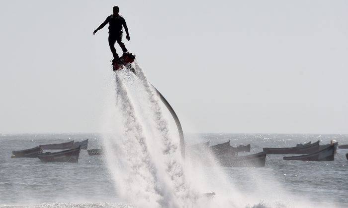 A man performs on a water-propelled flyboard on Sidi Bouzid Beach on August 16, 2014 in the Moroccan port city of El Jadida. (Fadel Senna/AFP/Getty Images)