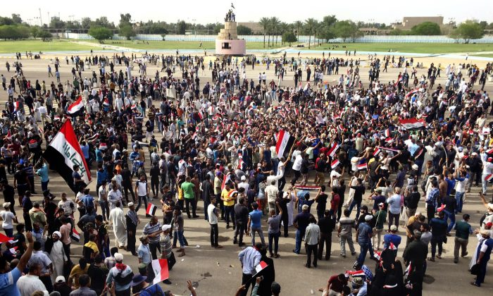 Supporters of Shiite cleric Muqtada al-Sadr attend a sit-in inside Baghdad's highly fortified Green Zone on May 1, 2016. Anti-government protesters tore down walls and poured into the Iraqi capital's heavily fortified Green Zone yesterday, where they stormed parliament in a major escalation of a political crisis that has simmered for months. (AP Photo/Karim Kadim)