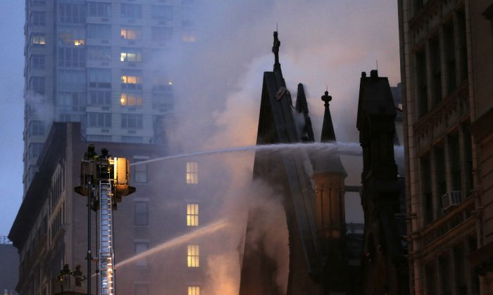 Firefighters battle flames at the historic Serbian Orthodox Cathedral of St. Sava, Sunday, May 1, 2016, in New York. The church that was constructed in the early 1850s and was designated a New York City landmark in 1968. (AP Photo/Kathy Willens)