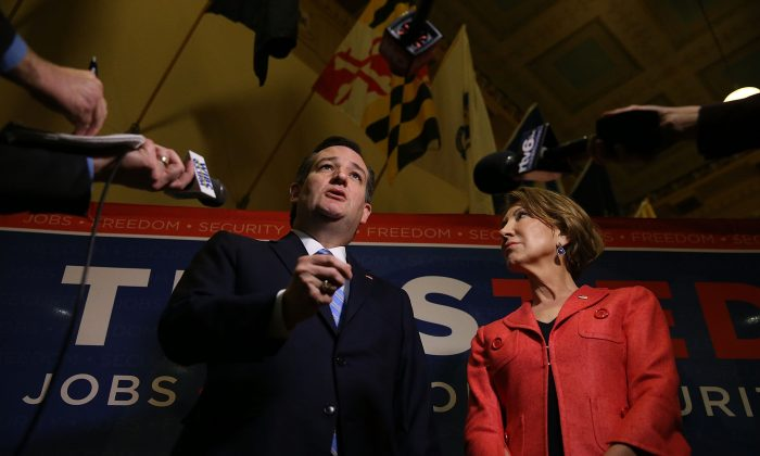 Republican presidential candidate Sen. Ted Cruz (R-TX) and his Vice Presidential candidate, former Hewlett-Packard chief executive Carly Fiorina, speak with the media before participating in a taping of Fox News Channel's The Sean Hannity Show at the Indiana War Memorial on April 29, 2016 in Indianapolis, Indiana. (Photo by Joe Raedle/Getty Images)