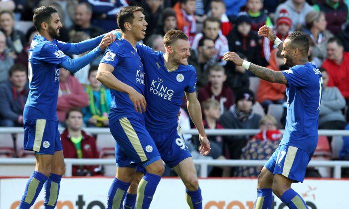 Leicester City striker Jamie Vardy celebrates scoring against Sunderland with Leonardo Ulloa, Riyad Mahrez, and Danny Simpson at the Stadium of Light in Sunderland on April 10, 2016. (Lindsey Parnaby/AFP/Getty Images)