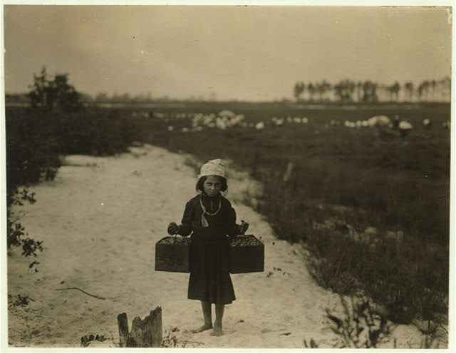 Rose Biodo, 10 years old. Working 3 summers. Minds baby and carries berries, two pecks at a time. This is the fourth week of school and the people here expect to remain two weeks more.  In Brown Mills, N.J., on Sept. 28, 1910. (L. W. Hine/LOC)