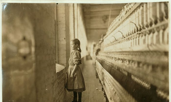 Rhodes Mfg. Co., Lincolnton, N.C. Spinner. A moments glimpse of the outer world Said she was 10 years old. Been working over a year. In Lincolnton, N. Carol., in November 1908. (L. W. Hine/LOC)
