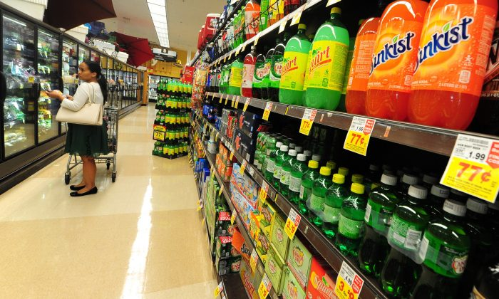 A woman shops for frozen foods on an aisle across from sodas and other sugary drinks for sale at a superrmarket in Monterey Park, California on June 18, 2014. (FREDERIC J. BROWN/AFP/Getty Images)