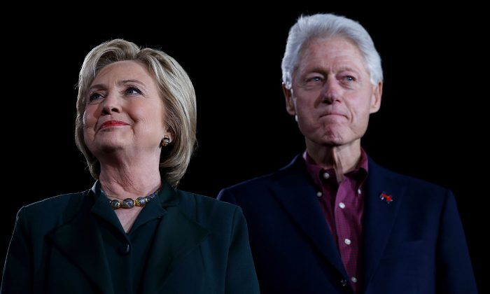 "Democratic presidential candidate former Secretary of State Hillary Clinton and her husband, former U.S. president Bill Clinton look on during a ""Get Out The Caucus"" at the Clark County Government Center on February 19, 2016 in Las Vegas, Nevada. (Justin Sullivan/Getty Images)"