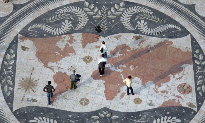 People walk on huge world map in Lisbon on Jan. 5, 2007. (Damien Meyer/AFP/Getty Images)