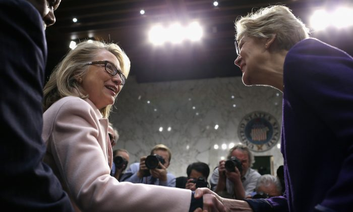U.S. Secretary of State Hillary Clinton (L) greets Sen. Elizabeth Warren (D-MA). (Photo by Chip Somodevilla/Getty Images)