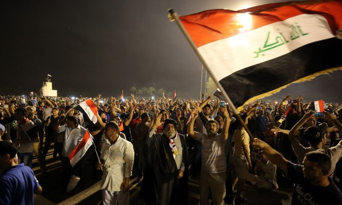 """Supporters of cleric Moqtada al-Sadr gather in the courtyard of celebrations after breaking into Baghdad's heavily fortified """"Green Zone"""" on April 30, 2016. Thousands of angry protesters broke into Baghdad's Green Zone and stormed the parliament building after lawmakers again failed to approve new ministers. Jubilant supporters of cleric Moqtada al-Sadr invaded the main session hall, shouting slogans glorifying their leader and claiming that they had rooted out corruption. (Ahmad al-Rubaye/AFP/Getty Images)"""