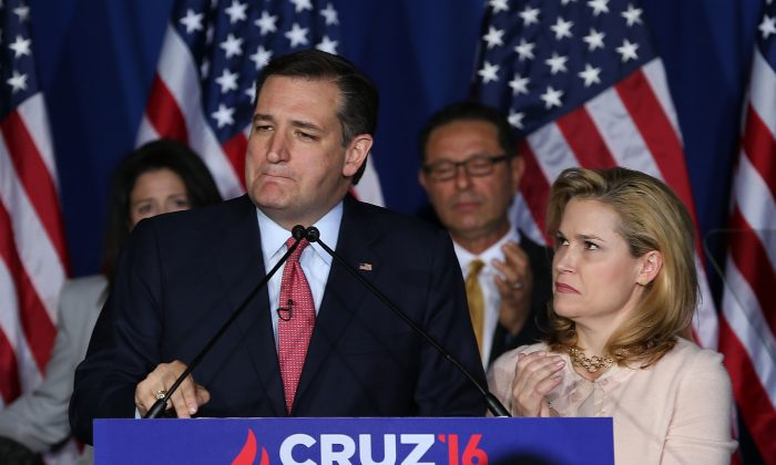 Republican presidential candidate Sen. Ted Cruz (R-Texas) announces the suspension of his campaign as wife Heidi Cruz looks on during an election night watch party at the Crowne Plaza Downtown Union Station in Indianapolis, Ind., on May 3, 2016. Cruz lost the Indiana primary to Republican rival Donald Trump. (Joe Raedle/Getty Images)