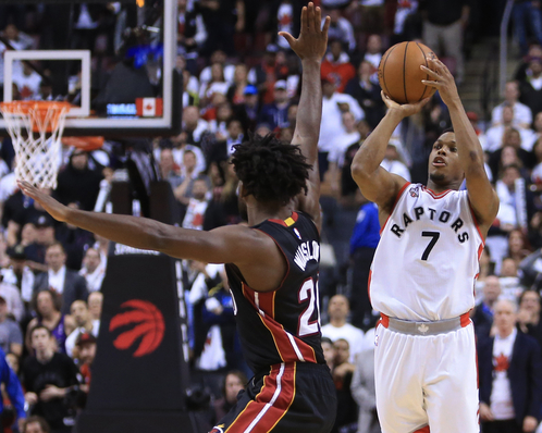 TORONTO, ON - MAY 03:  Kyle Lowry #7 of the Toronto Raptors hits a half-court buzzer beater to tie Game One and send it into overtime during the Eastern Conference Semifinals against the Miami Heat during the 2016 NBA Playoffs at the Air Canada Centre on May 3, 2016 in Toronto, Ontario, Canada.  NOTE TO USER: User expressly acknowledges and agrees that, by downloading and or using this photograph, User is consenting to the terms and conditions of the Getty Images License Agreement.  (Photo by Vaughn Ridley/Getty Images)