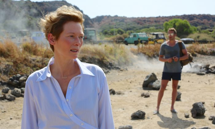 """This image released by Fox Searchlight shows Tilda Swinton (L)  and Matthias Schoenaerts in a scene from """"A Bigger Splash,"""" in theaters on May 4.  (Jack English/Fox Searchlight via AP)"""