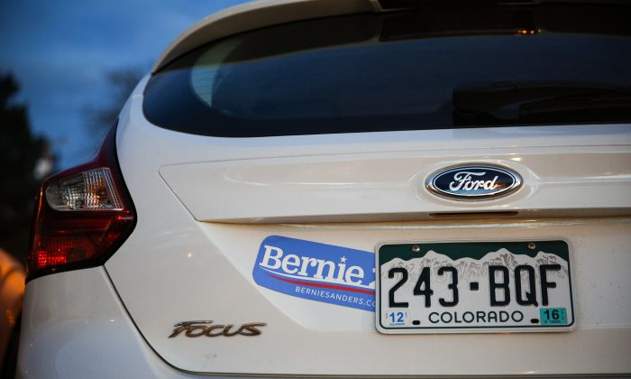 A Bernie Sanders sticker adorns a car in the parking lot of Manual High School as Colorado Democrats cast their vote. (Photo by Marc Piscotty/Getty Images)