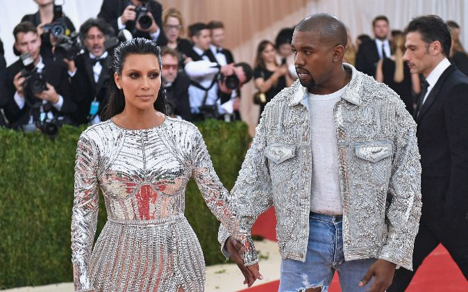 Kim Kardashian (L) and Kanye West attend the 'Manus x Machina: Fashion In An Age Of Technology' Costume Institute Gala at Metropolitan Museum of Art on May 2, 2016 in New York City. (Mike Coppola/Getty Images for People.com)