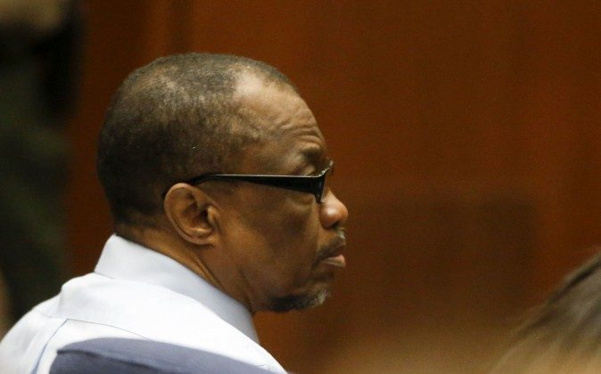 """Lonnie Franklin Jr., left, appears in Los Angeles Superior Court during closing arguments of his trail Monday, May 2, 2016, in Los Angeles. The """"Grim Sleeper"""" serial killer trial is coming to a close in Los Angeles after months of testimony. Franklin is charged with killing nine women and a 15-year-old girl between 1985 and 2007. They were shot or strangled and their bodies dumped in alleys and trash bins in South Los Angeles and nearby areas. (Mark Boster/Los Angeles Times via AP, Pool)"""