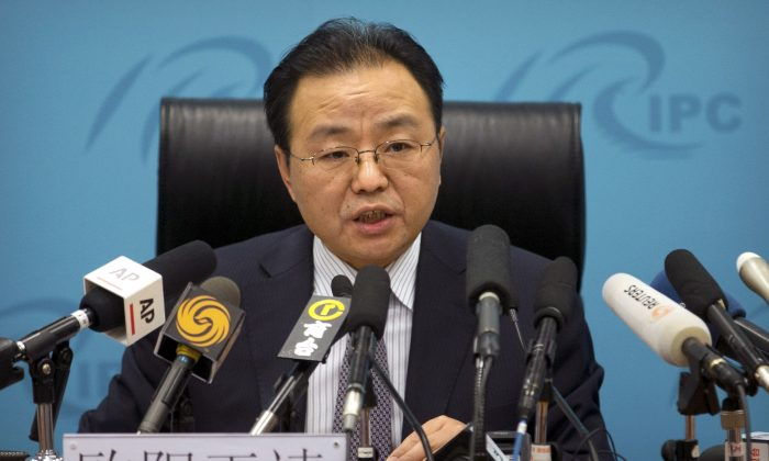 Ouyang Yujing, Director-General of the Department of Boundary and Ocean Affairs of China's Ministry of Foreign Affairs, speaks during a press briefing about China's South China Sea policies in Beijing, Friday, May 6, 2016. China is rallying Russia and other friendly states to back a push to exclude the U.S. and its allies from the festering South China Sea dispute, despite its insistence that countries without a direct territorial claim should remain firmly neutral. (AP Photo/Mark Schiefelbein)