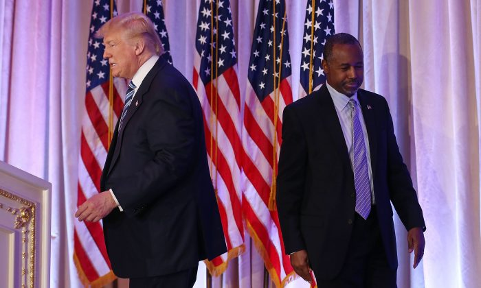 Republican presidential candidate Donald Trump and former presidential candidate Ben Carson are seen as Mr. Trump receives his endorsement during a press conference at the Mar-A-Lago Club on March 11, 2016 in Palm Beach, Florida. (Photo by Joe Raedle/Getty Images)