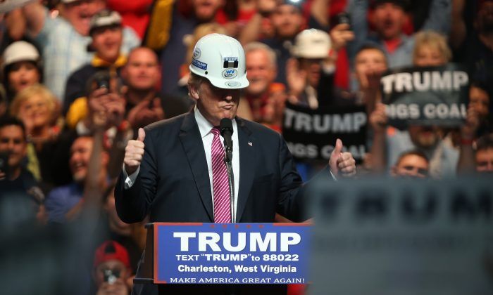 Republican Presidential candidate Donald Trump models a hard hat in support of the miners during his rally at the Charleston Civic Center on May 5, 2016 in Charleston, West Virginia. (Photo by Mark Lyons/Getty Images)