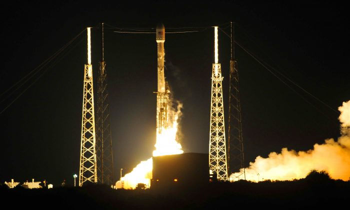 A SpaceX Falcon 9 rocket lights up the sky during a launch from the Cape Canaveral Air Force Station's Launch complex 40 early Friday morning, May 6, 2016, in Fla . Aboard is the JCSAT-14 communications satellite. SpaceX has done it again. For the second month in a row, the aerospace company landed a rocket on an ocean platform, this time following the launch of a Japanese communications satellite.  (Craig Rubadoux/Florida Today via AP)  NO SALES; MANDATORY CREDIT