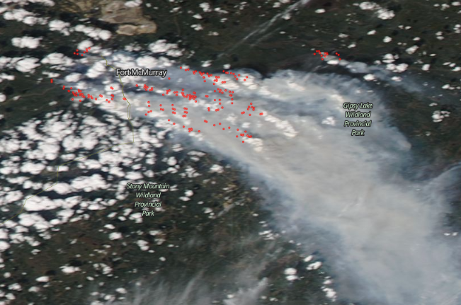 A May 5, 2016, satellite image of Fort McMurray with fires or heat anomalies marked in red. (Screenshot of NASA Worldview)