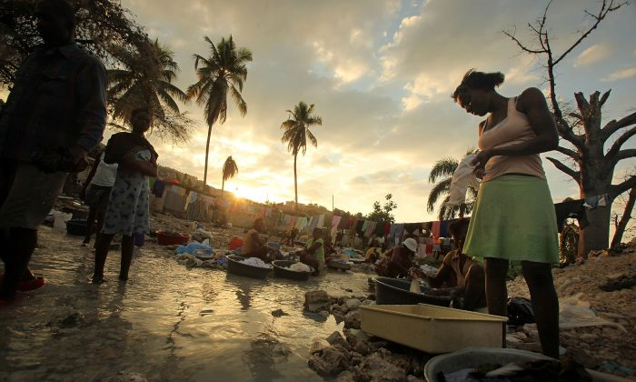 Haitians wash clothes in a stream in Port-au-Prince, Haiti, on Jan. 8, 2011. (Mario Tama/Getty Images)