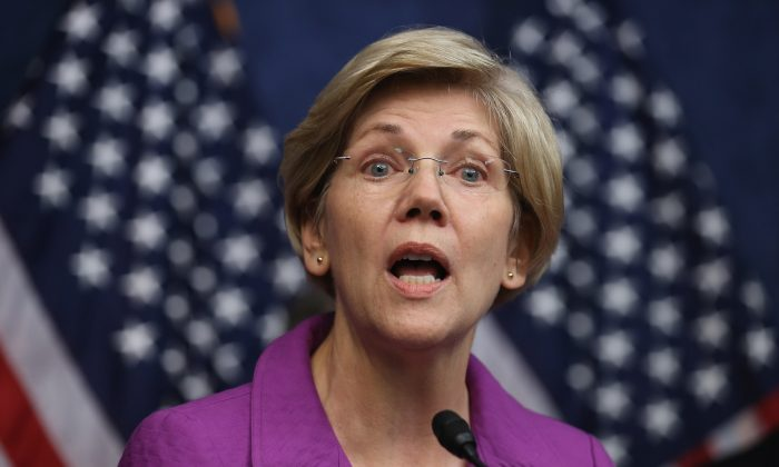 Sen. Elizabeth Warren (D-MA) delivers remarks during a news conference on the fifth anniversary of the Dodd-Frank Wall Street Reform and Consumer Protection Act at the U.S. Capitol Visitors Center July 21, 2015 in Washington, DC.  (Chip Somodevilla/Getty Images)