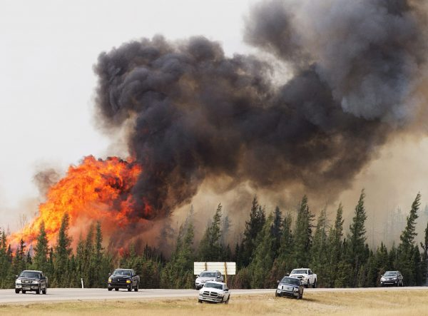 A wildfire burns south of Fort McMurray, Alberta, near Highway 63 on May 7, 2016. (Ryan Remiorz/The Canadian Press via AP)