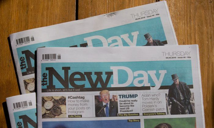 """Copies of The New Day newspaper pictured in south London on May 5, 2016. Britain's first new national daily newspaper in 30 years is to shut, its owners said Thursday, just over two months after it was launched promising to prove that print news can survive the Internet age. Trinity Mirror group said it was """"disappointing"""" that The New Day would print its last edition on Friday—just weeks after its launch on Feb. 29—but circulation had fallen """"below our expectations."""" (Justin Tallis/AFP/Getty Images)"""