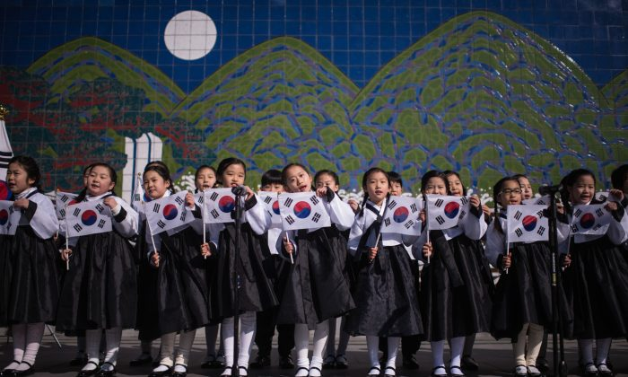 South Korean students wearing traditional costumes mark the 97th Independence Movement Day in Seoul on March 1, 2016. (Ed Jones/AFP/Getty Images)