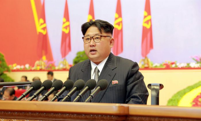 """North Korean leader Kim Jong-un reporting works of the North Korean Workers' Party Central Committee during the third day of the 7th Workers' Party Congress at the """"April 25 Palace"""" in Pyongyang on May 8, 2016. (KCNA/AFP/Getty Images)"""