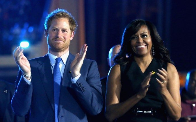 Prince Harry and Michelle Obama cheer during the Opening Ceremony of the Invictus Games Orlando 2016 at ESPN Wide World of Sports on May 8, 2016 in Orlando, Florida. Prince Harry, patron of the  Invictus Games Foundation is in Orlando ahead of the opening of Invictus Games which will open on Sunday. The Invictus Games is the only International sporting event for wounded, injured and sick servicemen and women. Started in 2014 by Prince Harry the Invictus Games uses the power of Sport to inspire recovery and support rehabilitation.  (Photo by Chris Jackson/Getty Images for Invictus)