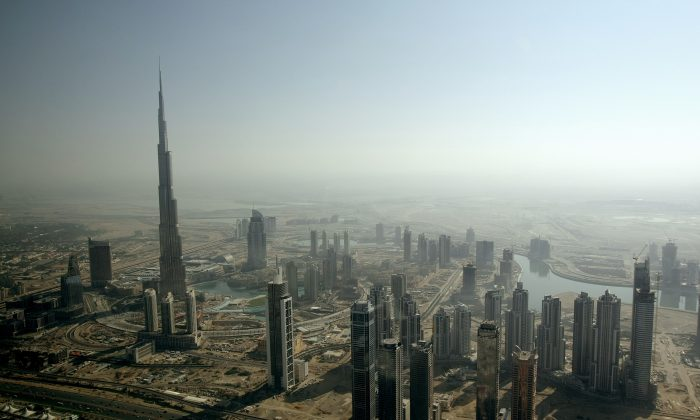 An aerial view shows Burj Dubai, the world's tallest tower built by Emaar property developer, rising among skyscrapers in the Gulf emirate of Dubai, United Arab Emirates, on Dec. 17, 2009. (Marwan Naamani/AFP/Getty Images)