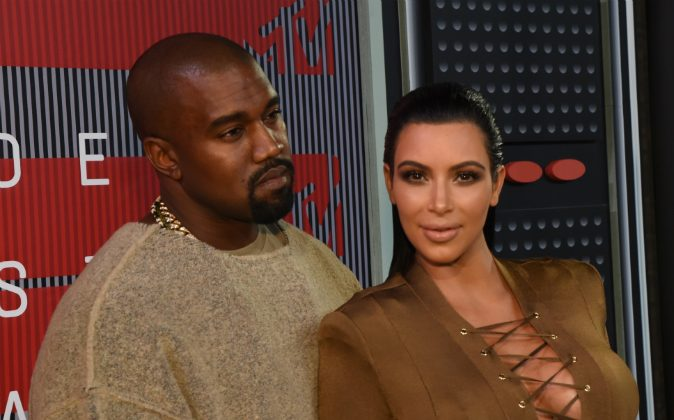 Recording artist Kayne West (L) and TV personality Kim Kardashian attend the 2015 MTV Video Music Awards at Microsoft Theater on August 30, 2015 in Los Angeles, California. (Larry Busacca/Getty Images)