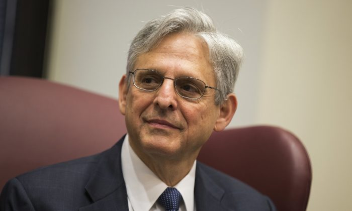 Judge Merrick Garland, President Barack Obama's choice to replace the late Justice Antonin Scalia on the Supreme Court, meets with Sen. Gary Peters (D-Mich.) in Capitol Hill on April 28, 2016. (Evan Vucci/AP Photo)