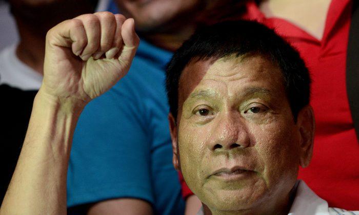 Philippine president-elect Rodrigo Duterte gestures during a campaign in Manila on April 23, 2016. (Noel Celis/AFP/Getty Images)