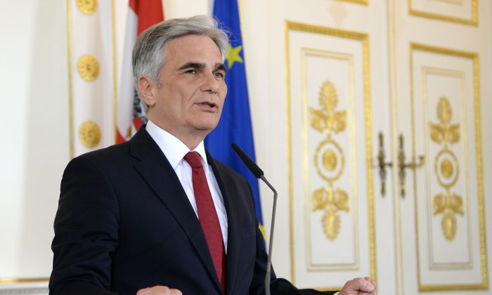 Austrian Chancellor Werner Faymann announces his withdrawal from all his offices during a press conference in Vienna, Austria, on May 9, 2016. (Roland Schlager/AFP/Getty Images)