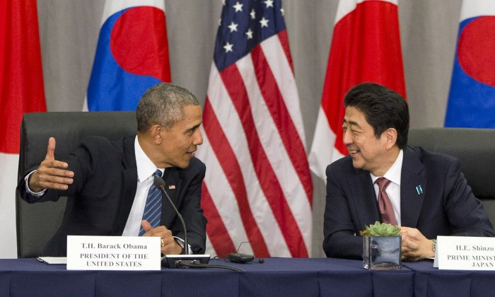 FILE - In this March 31, 2016, file photo, U.S. President Barack Obama speaks with Japanese Prime Minister Shinzo Abe during their meeting at the Nuclear Security Summit in Washington. Obama will travel to Hiroshima in May 2016 in the first visit by a sitting American president to the site where the U.S. dropped an atomic bomb. The White House says Obama will visit along with Abe during a previously scheduled visit to Japan. (AP Photo/Jacquelyn Martin, File)