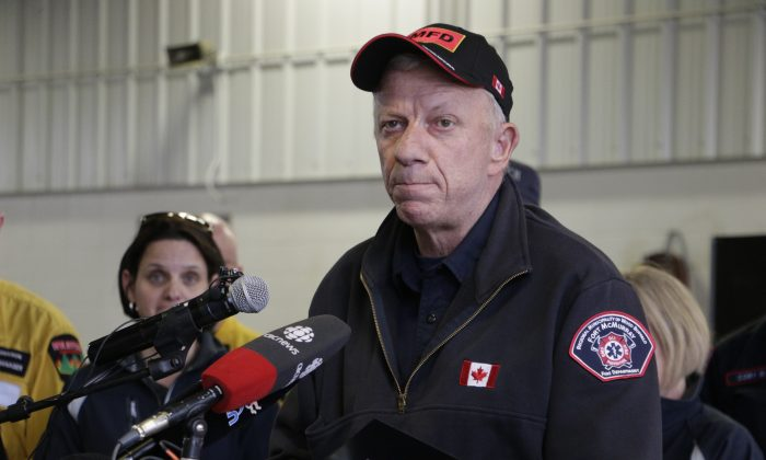 CORRECTS ATTRIBUTION- Fort McMurray, Alberta, fire chief Darby Allen speaks to members of the media at a fire station in Fort McMurray, Monday, May 9, 2016. A break in the weather has officials optimistic they have reached a turning point on getting a handle on the massive wildfire. (AP Photo/Rachel La Corte)