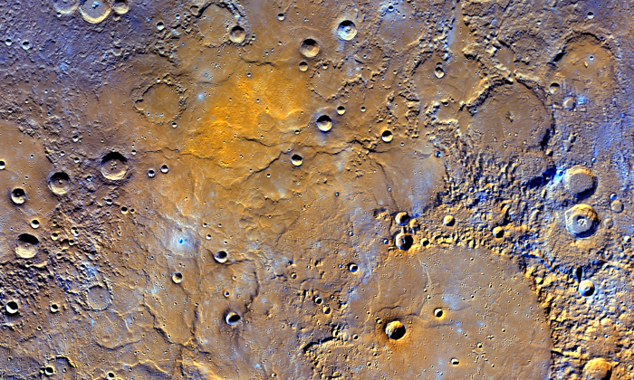 A view of Mercury's northern volcanic plains is shown in enhanced color to emphasize different types of rocks on Mercury's surface. (NASA/JHUAPL/Carnegie Institution of Washington)