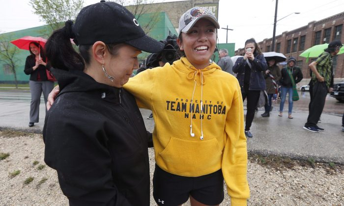 Kayleen McKay is greeted by her aunt Judy Pangman as she arrives at the Alexander Docks in Winnipeg on May 10, 2016. Family and friends welcomed McKay home after she raised over $10,000 during her 420-km run for Drag the Red. Drag The Red searches Winnipeg's Red River for murdered and missing people. (The Canadian Press/John Woods)