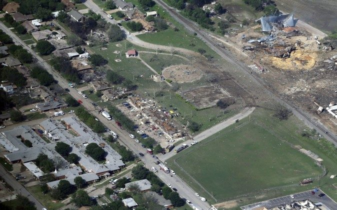 This April 18, 2013 aerial file photo shows the remains of a nursing home, left, apartment complex, center, and fertilizer plant, right, destroyed by an explosion at a fertilizer plant in West, Texas. Federal authorities announced Wednesday, May 11, 2016, that the fire that caused the deadly explosion in 2013 was a criminal act. The explosion killed 15 people, injured hundreds and left part of the small town in ruins. (AP Photo/Tony Gutierrez, File)
