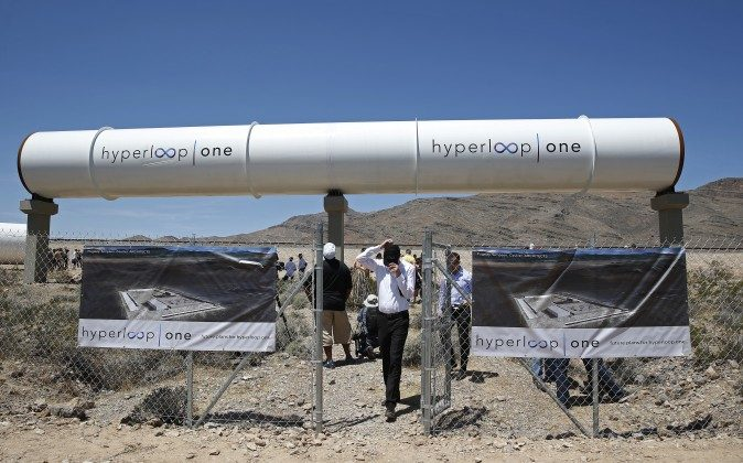 People tour the site after a test of a Hyperloop One propulsion system, Wednesday, May 11, 2016, in North Las Vegas, Nev. The startup company opened its test site outside of Las Vegas for the first public demonstration of technology for a super-speed, tube based transportation system. (AP Photo/John Locher)