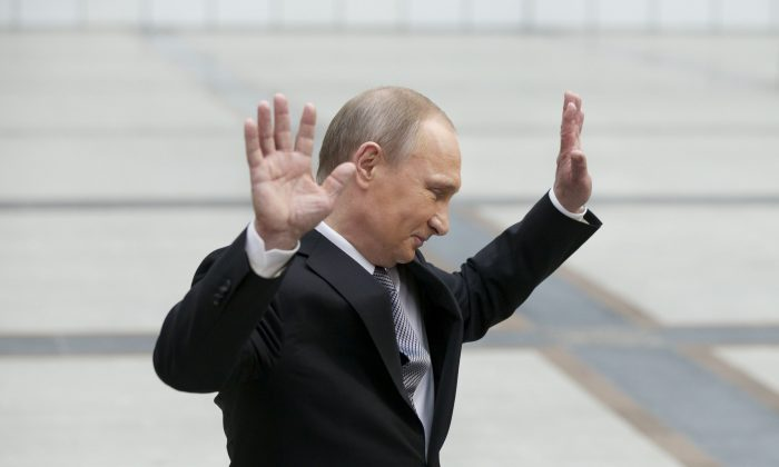 Russian President Vladimir Putin gestures after speaking to the media after his marathon call-in TV show in Moscow, Russia, on April 14, 2016. (AP Photo/Alexander Zemlianichenko)