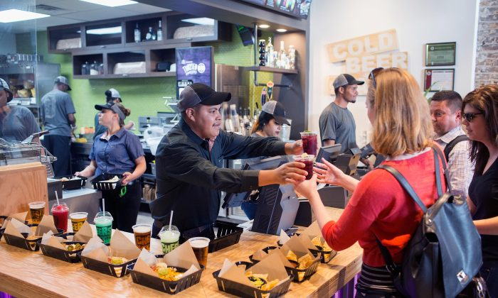 A worker serves customers at a Taco Bell Cantina restaurant in Chicago, Ill., on Sept. 22, 2015. (Scott Olson/Getty Images)