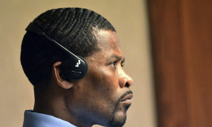 Jean Jacques listens to an interpreter through his headsets as Norwich Police Detective Anthony Gomes testifies during Jacques' murder trial at New London Superior Court in New London, Conn., on April 4, 2016. Jacques is on trial for the murder of Casey Chadwick in Norwich on June 15, 2015. The U.S. tried repeatedly to deport Jean Jacques, an immigrant living in the U.S. illegally, but his native Haiti wouldn't take him back after he served more than a decade in a state prison for attempted murder, and committed multiple parole violations. (Aaron Flaum/NorwichBulletin.com via AP)