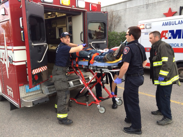 The suspect in attacks at Silver City Galleria mall is transported on a gurney into an ambulance by medical personnel in Taunton, Mass., Tuesday, May 10, 2016. Multiple people have been stabbed in separate deadly attacks at the mall and a home in Massachusetts. Authorities say an off-duty law enforcement officer shot and killed the suspect. (Charles Winokoor/The Daily Gazette via AP) MANDATORY CREDIT