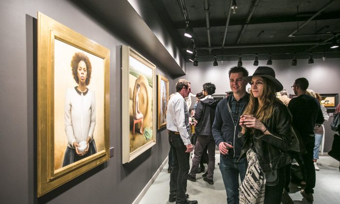 People look at paintings by Liz Beard at the opening night of the RESIDENTS group exhibition of Grand Central Atelier artists at Eleventh Street Arts in Long Island City, Brooklyn, on April 15, 2016. (Samira Bouaou/Epoch Times)