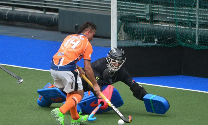 Khalsa's Inderpal Singh goes on to score two goals for his club in the Holland Cup semi-final against Pakistan Association at King's Park on Sunday May 8, 2016, when he rounds the keeper not once but twice. (Eddie So)