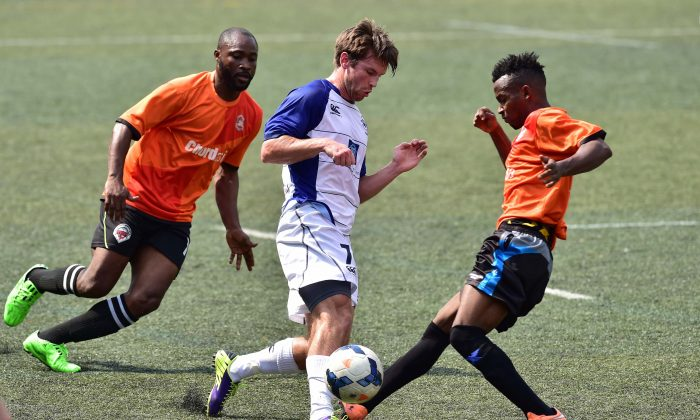 Football action in an early season match between Albion and Corinthians in the HKFA first division at Sports Road on Oct 18, 2015. (Bill Cox/Epoch Times)
